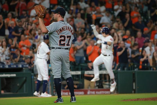 Detroit Tigers pitcher Jordan Zimmermann (27) waits for the ball as Houston Astros' Alex Bregman rounds third base after his two-run home run in the fourth inning on Thursday.