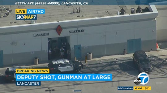 This photo taken from video provided by KABC-TV shows the outside of a Los Angeles County sheriff's station in Lancaster, Calif., on Wednesday, Aug. 21, 2019. The mayor of Lancaster says a deputy shot and wounded outside the station is going to be Okay after he visited him at the hospital. Authorities are searching for the shooter in buildings surrounding the station where the deputy was hit in the shoulder while standing in the parking lot Wednesday afternoon.
