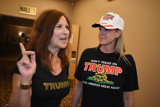 Kathy Zalmanski, left, of Clinton Township, and Lisa Mankiewicz, Shelby Township show their support for Trump in 2020 at An Evening to Empower at the American Polish Cultural Center in Troy on Thursday. (Brandy Baker / Special to the Detroit News)