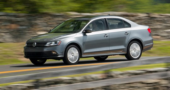 Volkswagen is recalling about 679,000 cars in the U. S., including the 2015 Jetta, shown, to fix a problem that could let the cars roll away unexpectedly.