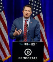 Former Democratic presidential candidate Rep. Seth Moulton, D-Mass., gestures while speaking at the Democratic National Committee's summer meeting Friday, Aug. 23, 2019, in San Francisco. Moulton announced he is dropping from the race.