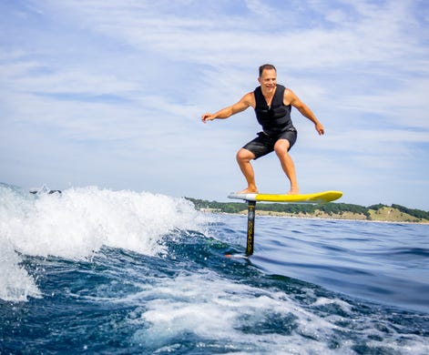 Ken Osiwala of St. Clair rides his hydrofoil on Lake Michigan. Surfers call it surf foiling or foil boarding.