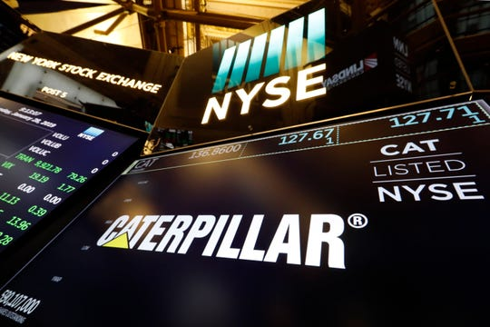 FILE - In this Jan. 28, 2019, file photo the logo for Caterpillar appears above a trading post on the floor of the New York Stock Exchange. A knee-jerk reaction in the market is to sell big industrial companies whenever trade worries rise. The temptation makes sense given how global the companies are, but it may be misguided, said Stephen Volkmann, an equity analyst at Jefferies who covers machinery and industrial companies.