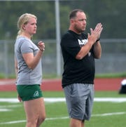 Head coach Zach Sarno leads the Elmira girls soccer practice Aug. 22, 2019 at Ernie Davis Academy. Next to him is Elmira graduate Sierra Barr, one of the top players in Express history.