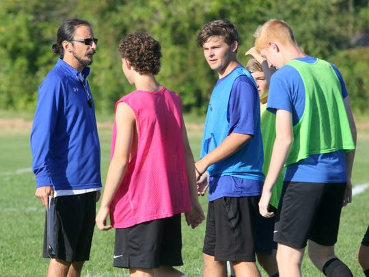 Horseheads boys soccer coach Mark Mucci talks to his players at practice Aug. 23, 2019 at Horseheads High School.