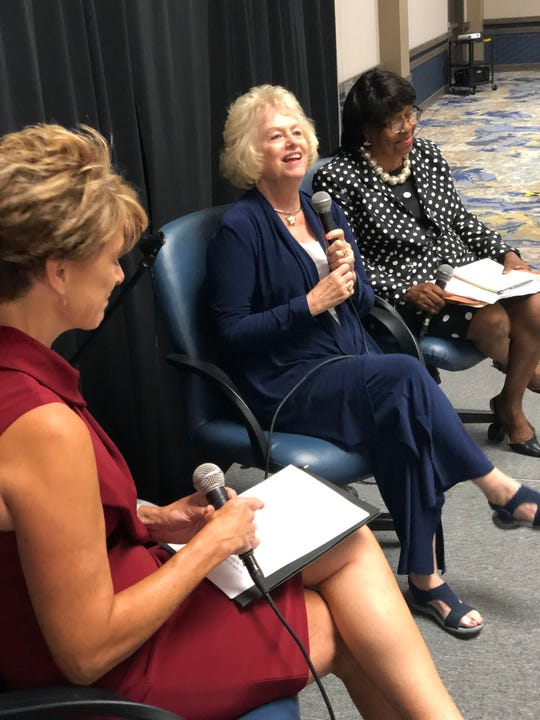 Shelley Kirk helped moderate a discussion with Senators Vaneta Becker and Jean Breaux at Friday's Women's Equality Day Program.