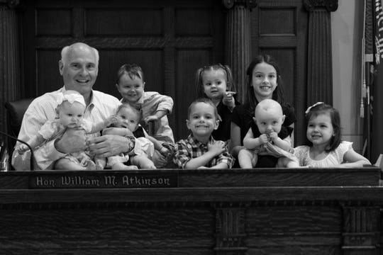 William Atkinson, a longtime Brown County judge, expects to have his hands full with grandchildren in his retirement.