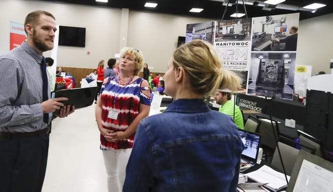 Dylan Bullock explores different job opportunities at the job fair for Veterans on Thursday, Aug. 22, 2019, located at 7001 Gass Lake Rd in Manitowoc, Wis. Ebony Cox/USA TODAY NETWORK-Wisconsin