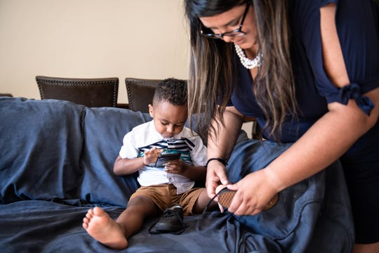 Rut Rivera puts shoes on her son, Marcel Rivera, 3, at their home in Simpsonville, Thursday, August 22, 2019. As mass shootings have increased in frequency, Rut Rivera has developed a more acute awareness of her surroundings when she is in public places with her family, looking for escape routes and places to hide in the event of a mass shooting.