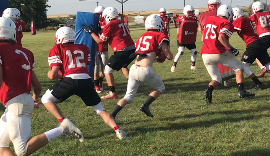 The Conrad Cowboys work on a rushing drill during practice earlier this week.