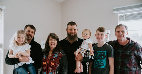 A recent photo shows Tammy Goff, third from left, with members of the Goff family. From left to right: Tammy's granddaughter Hope, son Jesse, Tammy, son Josh, granddaughter Olivia, grandson Joshua and husband Bob.