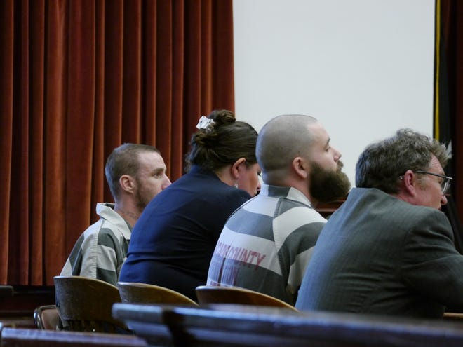 From left, Troy Allan Nelson, attorney Claire Lettow, Ryan Patrick Morris and attorney Mark Frisbie listen as Judge Greg Pinski addressed the concept of stolen valor Friday, Aug. 23, 2019.