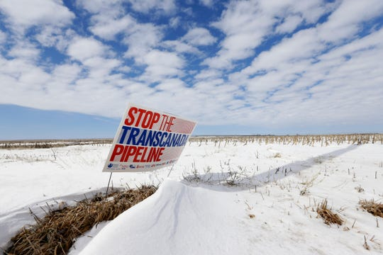 "FILE - In this March 11, 2013, file photo is a sign reading ""Stop the Transcanada Pipeline"" placed in a field near Bradshaw, Neb.  Nebraska's highest court lifted one of the last major hurdles for the Keystone XL pipeline on Friday, Aug. 23, 2019 when it rejected another attempt to derail the project by opponents who wanted to force the developer to reapply for state approval. (AP Photo/Nati Harnik, File)"