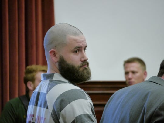 Ryan Patrick Morris, who falsely claimed to have served in the military, attends a hearing in district court Friday, Aug. 23, 2019.