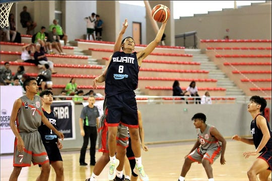 Guam's Daryll Robles grabs a rebound against the home team New Caledonia Aug. 23 at the FIBA U17 Oceania Basketball Championship.