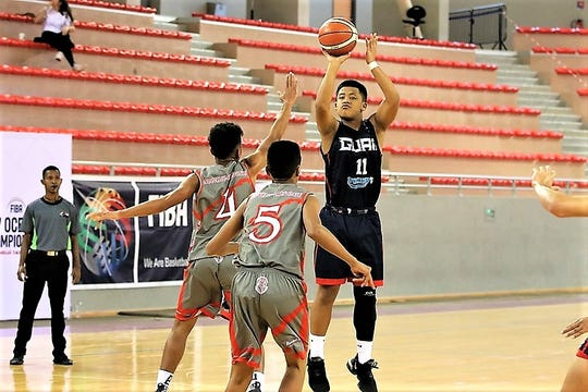 In this file photo from August 2019, Elijah Garrido takes a shot against the home team New Caledonia at the FIBA U17 Oceania Basketball Championship in Noumea, New Caledonia.