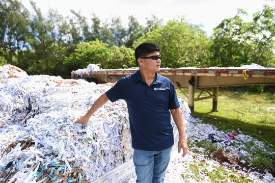 Jesse Bamba, University of Guam cooperative extension and outreach, discusses the use of shredded paper during a tour at Watson Farm in Yigo, Aug. 23, 2019.