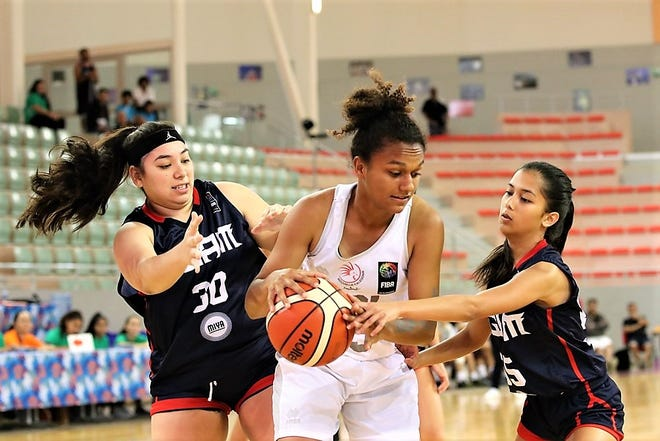 In this file photo from August 2019, Guam's Madison Borja, left and Alana Salas, right, harass an opponent from the home team New Caledonia Aug. 23 at the FIBA U17 Oceania Basketball Championship in Noumea, New Caledonia.