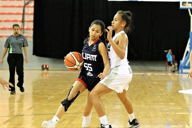 Alana Salas drives around an opponent in Guam's 75-72 win against New Caledonia Aug. 23 at the FIBA U17 Oceania Basketball Championship in this file photo. Salas, a senior at George Washington High is co-Most Valuable Player for 2019 IIAAG Girls Basketball.