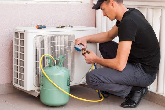 As the U.S. moves to ban R22 freon, homeowners replace air conditioners.