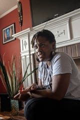Brittany Gray, seated in her living room, Saturday, June 15, 2019, discusses the extremely high gun violence in her hometown, Greenwood, Miss.