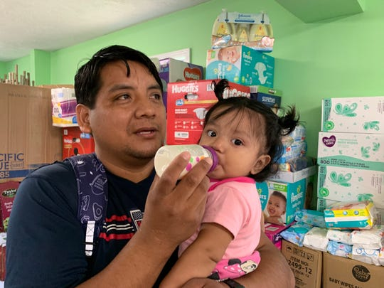Romeo Ramirez bottle-feeds his 9-month-old daughter, Elizabeth, on Aug. 22, 2019. Up until her mother was arrested by immigration officials during a large scale workplace sting on Aug. 7, 2019, Elizabeth was breastfed, according to Ramirez.