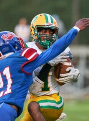Taylorsville receiver Jabez Griffith (1) hauls in a touchdown pass against Scott Central  Aug. 22 in Forest, Mississippi.(Bob Smith/Special to the Clarion Ledger)