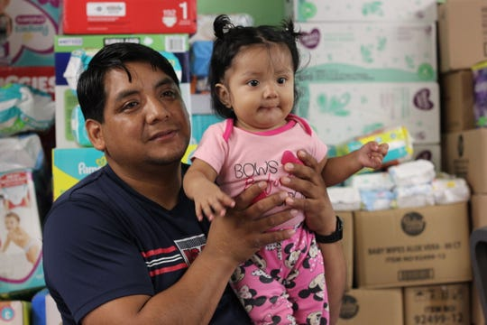 Romeo Ramirez holds his daughter, 9-month-old Elizabeth, on Aug. 22, 2019. The baby was breastfed until her mother was arrested by immigration officials during raids in Mississippi on Aug. 7, 2019.