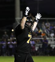 Peabody's Conner Gatlin (73) celebrates a touchdown against Milan during Week 1 football at Peabody on Aug. 22, 2019.