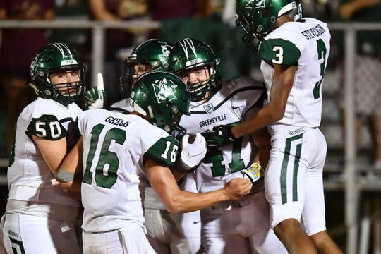 Teammates celebrate with Ty Youngblood (47) after he scored a touchdown against Powell on Thursday, August 22, 2019.