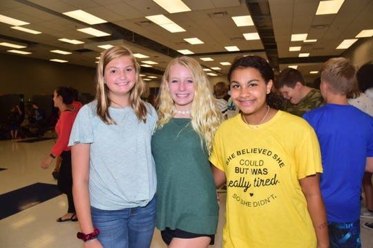 "Besties Hunter Goodman, 13, Lauren Lanning, 12, and Alayzha Johnson, 12, pose for the camera at the Hardin Valley Middle School ""Back to School"" dance Tuesday, Aug. 20. 2019"
