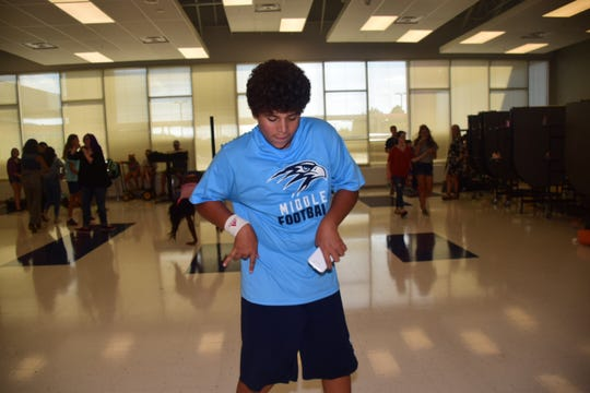 "Preston Clark, 13,  shakes it to Taylor Swift's ""Shake it Off"" at the Hardin Valley Middle School ""Back to School"" dance."