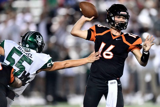 Powell's Walker Trusley (16) is pressured by Greeneville's Leyton Mitchel (55) in the high school football game at Powell on Thursday, August 22, 2019.