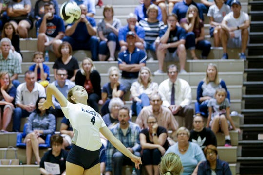 Central Catholic outside hitter Lydia Baker (4) leaps up to spike the ball during the first set of an IHSAA girls volleyball match, Thursday, Aug. 22, 2019 at Harrison High School in West Lafayette. Central Catholic won, 3-2(22-25, 26-24, 25-20, 19-25, 15-12).