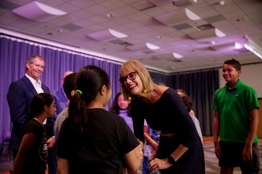 "Lt. Gov. Suzanne Crouch greets students before an award presentation, Friday, Aug. 23, 2019 at West Lafayette Intermediate School in West Lafayette. Eleven WLCSC students received the first ""Brilliant Firefly"" award for outstanding achievement and community involvement."