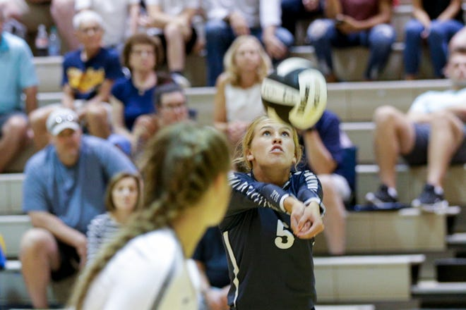 Central Catholic libero Kaycie Hicks (5) hits the ball during the first set of an IHSAA girls volleyball match, Thursday, Aug. 22, 2019 at Harrison High School in West Lafayette. Central Catholic won, 3-2(22-25, 26-24, 25-20, 19-25, 15-12).