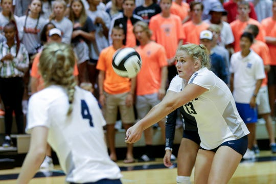 Central Catholic outside hitter Jozee Evans (13) hits the ball during the second set of an IHSAA girls volleyball match, Thursday, Aug. 22, 2019 at Harrison High School in West Lafayette. Central Catholic won, 3-2(22-25, 26-24, 25-20, 19-25, 15-12).