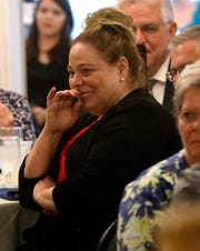 Carri Brown, Fairfield County administrator, reacts as she realizes she's the recipient of the 2019 Athena Award during a ceremony in August. She will officially retire on March 31, but will continue working as the county commissioners rehired her effective April 1.