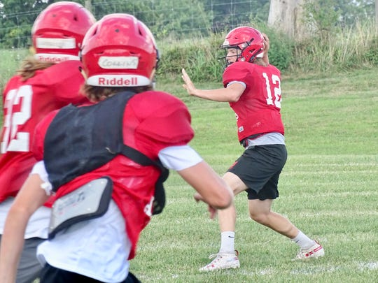 Fairfield Union senior quarterback Blayde Patton gets set to throw a pass during practice. He is a returning starter.