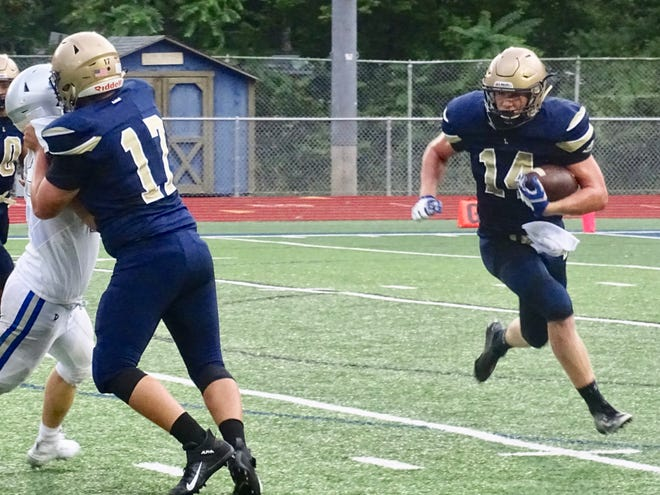 Lancaster's Curtis Young runs the ball as he gets a block from Dominic Carpenter during the Golden Gales' scrimmage against Central Crossing Thursday at Fulton Field.