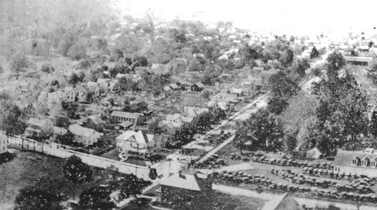 The Hoskins' house on the SW corner of Fair Ave. and High St. is shown in the center of the photo. It is on the left (south) side of Fair Ave. across from the cars parked on the fairgrounds. This circa 1915 photo is from the book Fairfield County Memories, p.56, published by the Lancaster Eagle-Gazette.