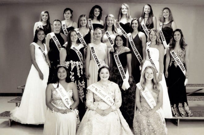 The 2019 contestants in the Sweet Corn Festival Queen's Pageant stand behind the 2018 court. The event will be 7:30 p.m. Thursday at the Brookover-Harlow Pavilion.
