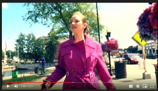 """In this screen shot of a music video, Macy Goller stars in a video for Angela Predhomme's new song """"Sweet Delectable You,"""" shot in downtown Brighton in August 2019."""