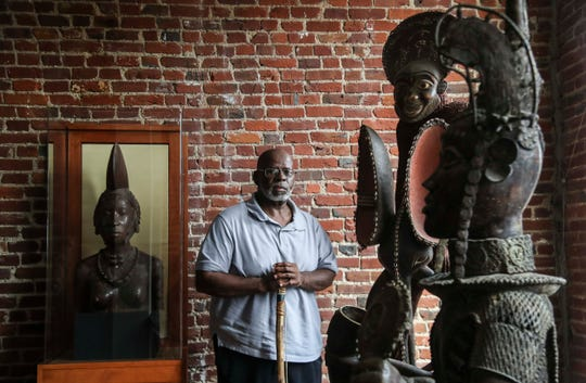 Lamont Collins, among African artifacts, is the founder and CEO of a museum planned to open in early 2020 that takes visitors on a journey of the African American experience.