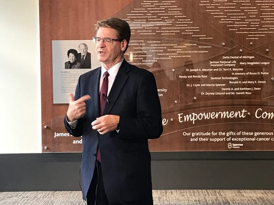 Sparrow Health System CEO James Dover talks to a reporter Friday, August 23, 2019 at the Herbert-Herman Cancer Center