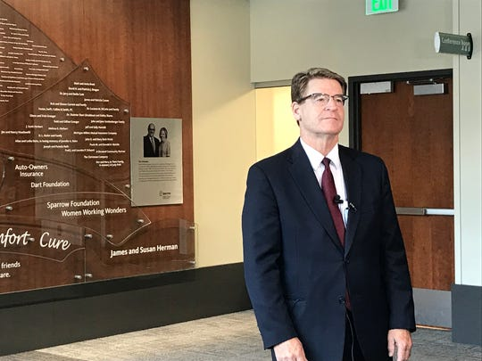Sparrow Health System CEO James Dover prepares to talk to a reporter Friday, August 23, 2019 at the Herbert-Herman Cancer Center