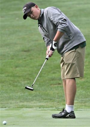 Madison's Jaekob Conard lines his putt up during the Tyger Invitational last week.