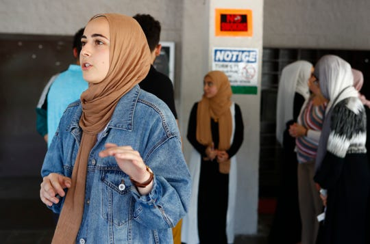 Mariam Khayata, a sophomore at Rhodes College, talks about the effort to reach potential voters as she volunteers during a registration drive. The drive was part of a National Muslim Voter Registration Day event held at the Muslim Society of Memphis on Aug. 23.