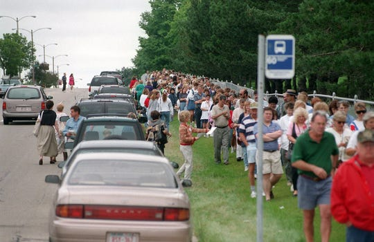 Crowds line up hours ahead of time for the Starving Artists' Show at Mount Mary University. Here, the line forms along West Burleigh Street as the gates open for the 1997 Starving Artists' Show. The 2019 edition is Sept. 8.