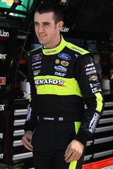 Austin Cindric, driver of the No. 22 Menards Team Penske Ford Mustang, waits to practice Friday.